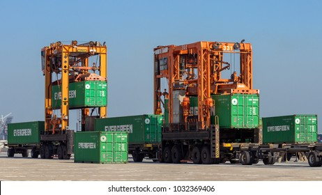 ROTTERDAM - SEP 6, 2015: Straddle carriers moving cargo containers in the ECT shipping terminal in the Port of Rotterdam.