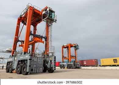 ROTTERDAM - SEP 6, 2015: Straddle carrier moving a container in a container terminal in the Port of Rotterdam