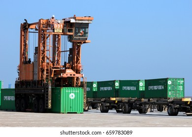 ROTTERDAM - SEP 6, 2015: Straddle carriers moving containers in a shipping terminal in the Port of Rotterdam