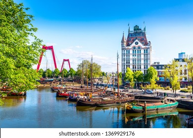 Rotterdam, South Holland, The Netherlands - May, 2018: Oude Haven harbor, Willemsbrug bridge, old ship yard dock, Ships, Openlucht Binnenvaart Museum during sunny summer day in Rotterdam.