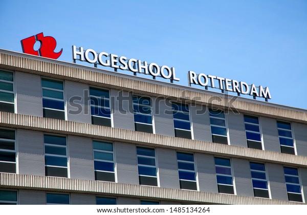 """Rotterdam, Zuid Holland, The Netherlands : Aug 22nd, 2019. Detail shot of the Hogeschool Rotterdam building against a  blue sky. Showing """"Hogeschool Rotterdam"""".Translation: """"High School Rotterdam""""."""