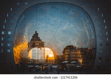 Rotterdam/The Netherlands - March 19th 2015: Reflection of cityscape in Rotterdam on the facade of Market Hall (Markthal) during golden hour