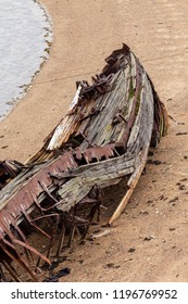 Rotting, abandoned ship on the shore, a symbol of decadence and degradation