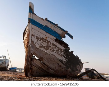 Rotting wooden boat on the beach, Novo Sancti Petri, Andalusia, Spain, Europe