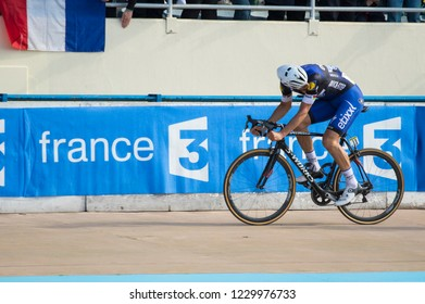Roubaix, France - April 10, 2016: Intense moment when Tom Boonen looks back over his shoulder ahead of a sprint finish during Paris-Roubaix bicycle race