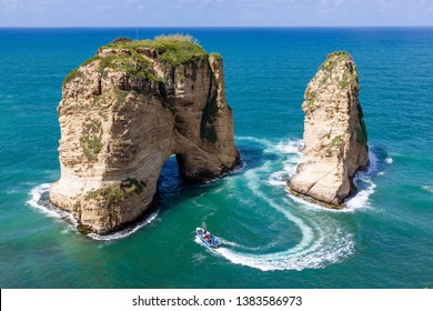 Rouche rocks in Beirut, Lebanon in the sea during daytime. Pigeon Rocks in Mediterranean sea.