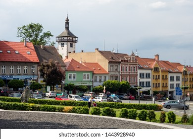 ROUDNICE NAD LABEM, CZECH REPUBLIC - MAY 25, 2019: Karlovo namesti town square in Roudnice nad Labem with parking cars and the stone tower Hlaska in the background