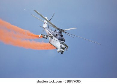 Roudnice nad Labem, CZECH REPUBLIC - JUN  27.: Czech Air Force Mi-24 attack helicopter flying a demonstration at the MEMORIAL AIR SHOW 2015 on June 27., 2015 in Roudnice nad Labem, Czech republic.