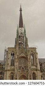 ROUEN, FRANCE, DECEMBER 9, 2018,  Gothic spire of Rouen cathedral in scaffolding for reconstruction works. Rouen, 9 December 2018