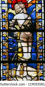 Rouen, France - February 10, 2013: Stained glass window depicting Saint Sebastian in the Cathedral of Rouen, France.
