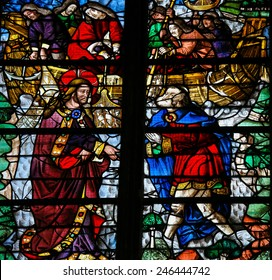 "ROUEN, FRANCE - FEBRUARY 10, 2013: Stained glass window depicting Jesus calling Simon Petrus (Saint Peter) to become a ""fisher of men""  in the Cathedral of Rouen, France."