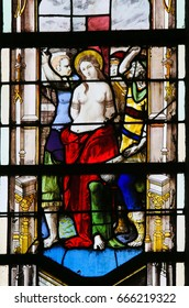 ROUEN, FRANCE - FEBRUARY 10, 2013: Martyrdom of a Catholic Saint on a stained glass in the cathedral of Rouen, France