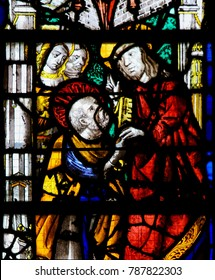 Rouen, France - February 10, 2013: Jesus and Saint Peter on a stained glass in the cathedral of Rouen, France