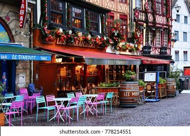 Rouen, France - January 09, 2014: Vieux Marche square. Vieux Marche square in Rouen, France. Half-timbered medieval houses, street cafe. Christmas Holidays