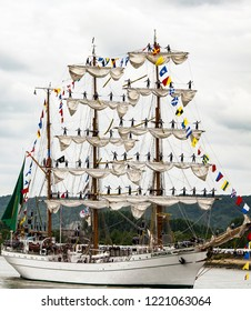 ROUEN, FRANCE - JULY Circa, 2016. End of the Armada in Rouen, boats galleon ships on the river Seine. Differents naval transportation going to their country. Men woman standing up on the matts boat