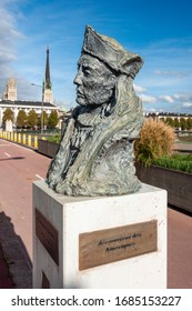 Rouen, France - October 26, 2014: Bust of Christopher Columbus (1451-1506) on Pont Boieldieu, near the Seine river. Sculpteur jean-marc de pas. The sign reads 'Discoverers of America'.