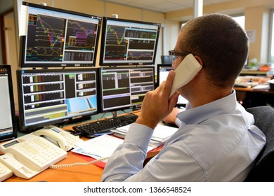 Rouen, Normandie, France, september 2015. Trading room. Negociation for futures markets. Trader with telephone.Purchase/sale orders. Computers with information of Stock Exchange & Fluctuations