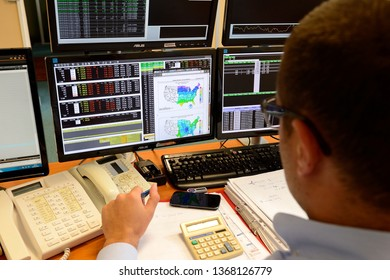 Rouen, Normandie, France, september 2015. Trading room. Negociation for futures markets. Trader with telephone. Purchase/sale orders. Computers with information of Stock Exchange & Fluctuations