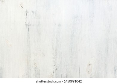 Rouge white painted wood texture as background.