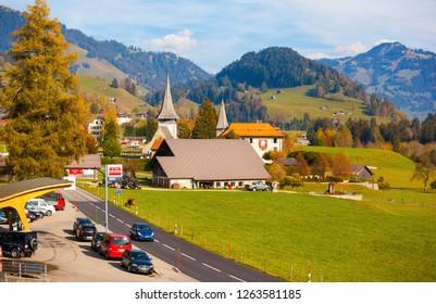 ROUGEMONT/SWITZERLAND-OCT 19: Scenery along the Golden Pass Line-Rougemont town on Oct 19 2018 in Rougemont, Switzerland.