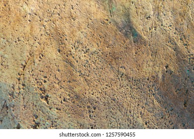 Rough brown rock surface background and texture
