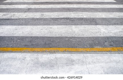 Rough cross road black white yellow line horizontal perspective texture background clear floor with soft focus
