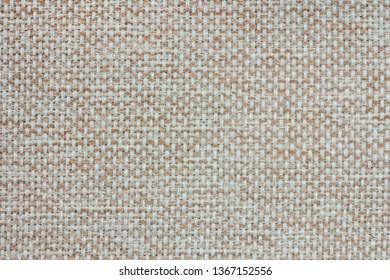 Rough fabric texture. Coarse cloth structure. Woven canvas. Burlap backdrop.