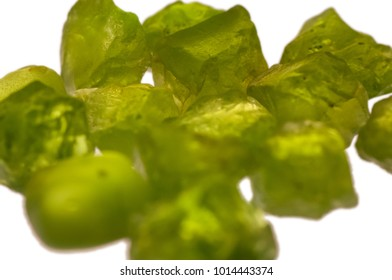 Rough green peridot stones prior to faceting