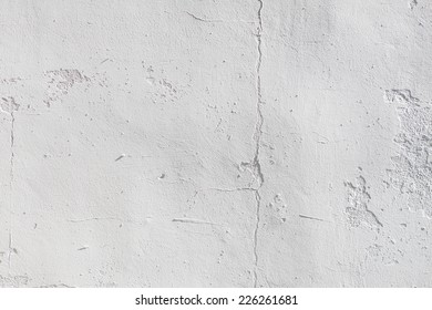 rough grey wall texture closeup at sunny day
