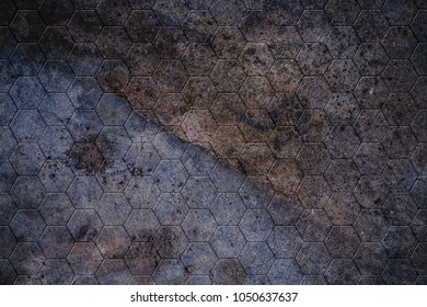 Rough grunge cement texture from an old concrete wall with honeycomb mosaic or hexagonal geometric pattern.