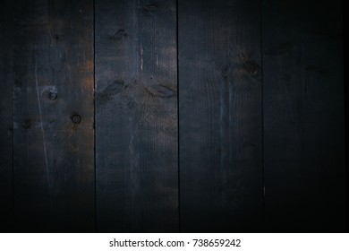 Rough grunge texture of black wooden background, closeup