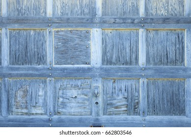 Rough and grungy wood texture of old weather beaten door