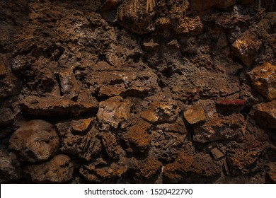 Rough hard grunge mud clay texture trench. Rock stone soil land background. Dark ground wall rocky cold terrible dungeon backdrop. Excavation work, vintage template for outdoor mine quarry 3d design