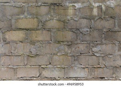 A rough and heavily textured cinder block wall suitable for backgrounds.