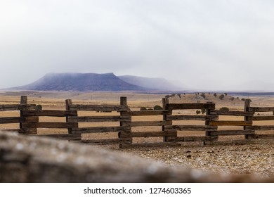 rough hewn wooden corral in the high desert of Arizona in sleeting weather