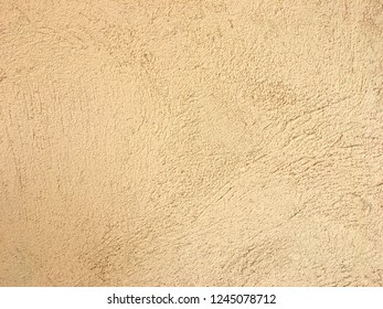 Rough light yellow concrete wall texture. Wrinkle pattern after plaster background.