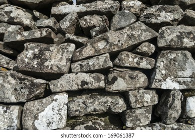 Rough limestone dry stone wall background.