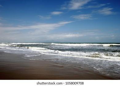 Rough ocean waves and blue skie