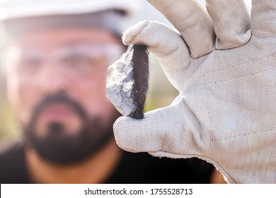 rough ore stone, palladium nugget. Concept of metal mining used in the industry. Spot focus