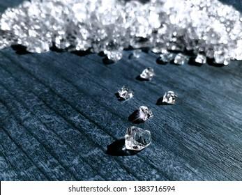 Rough raw herkimer diamond (brilliant) stone mine concept. Little crystals of diamond or brilliant. Rich luxury brilliant gem light background closeup macro. Gemstone glamour valuable shine background