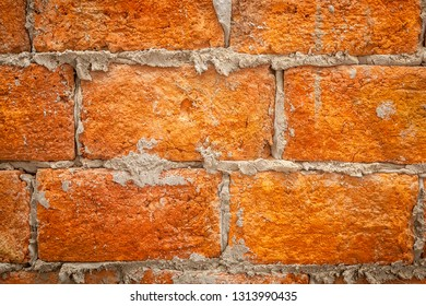Rough Red Brick Wall with mortar drips and gaps
