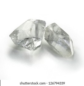 Rough rock crystal gems stones on the simple white background
