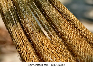 A Rough and scruffy rope  hammock hanging on the beach,selective focus.