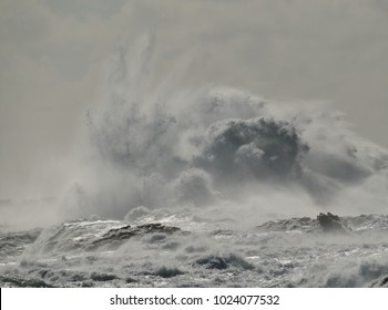 Rough sea and big explosion of water, wave breaking on the rocks, coast of Gran canaria