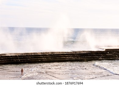 The rough sea with large waves breaking on the coast
