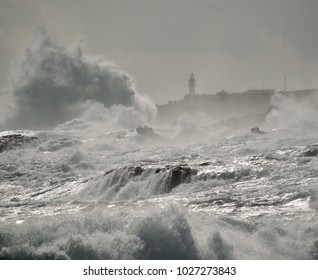 Rough sea on the coast, big waves and lighthouse, La Garita, Gran canaria, Canary islands