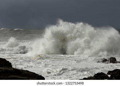Rough sea wave splash, Northern portuguese rocky coast in a stormy day.