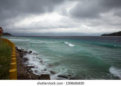 Rough seas during typhoon season on rocky beach - Bicol region of Philippines