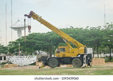 Rough Terrain Crane while installation satellite dish structure in the green field