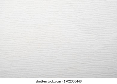 Rough texture background, close-up white tissue paper, abstract pattern horizontal emboss.